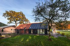 This Barn Living is a renovated farmhouse with the extended old barn next to the house. Located in Aalten, Netherlands, the farmhouse renovation and extension of the barn were designed by Bureau Fraai in 2015 for a young family. Metal Facade, Farmhouse Renovation, Barn Living, Best Architects, Small Buildings, House Extensions, Old Barns, House And Home Magazine, Old Houses