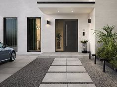 We've put together some of our favorite outdoor pool tile and patio tile ideas to help you get inspired in your own backyard! Modern Driveway, Driveway Design, Modern Front Yard, Modern Porch, Stone Driveway, Front Yard Design, Modern Entrance Door, House Entrance, Driveway Entrance