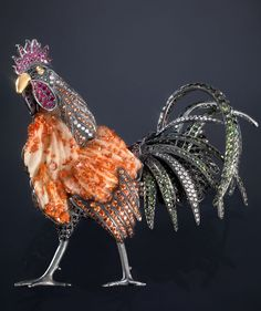 Luz Camino, rooster brooch, with a matrix gemstone for the body