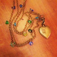 Vintage french heart locket on brass chain with tiny glass flowers