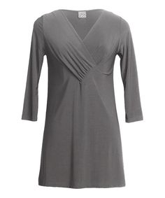 With timeless tunics like this, endless ensembles await. Soft, solid-hued and always in style, this piece is a modern must-have.Measurements (size S): 28'' long from high point of shoulder to hem70% polyester / 20% rayon / 10% spandexMachine wash; hang dryMade in the USA