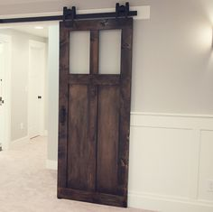 Handmade barn door in the craftsman style with two acrylic glass inserts...for my office?