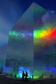 """ianbrooks: """" Holographic Cube Building by Hiro Yamagata Originally made for the Guggenheim Bilbao Museum, this installation covered two buildings in holographic panels that shifted color once lasers. Futuristic Architecture, Facade Architecture, Beautiful Architecture, Contemporary Architecture, Contemporary Building, Unique Buildings, Interesting Buildings, Amazing Buildings, City Buildings"""