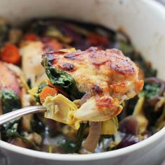 Baked Chicken with Spinach and Artichokes: the perfect recipe for Benissimo Mediterranean Garlic oil. We added feta and kalamata olives for even more Mediterranean flair. Easy and delicious is a great combo!