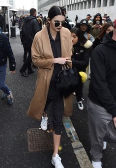 Keep a camel coat and circle sunglasses like Kendall Jenner in your wardrobe essentials