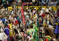 2014 Gathering of Nations Pow Wow; picture of 2013 gathering.  Links on page to open up flyer, website, vendor application, advanced tickets.....