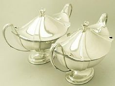A very fine and impressive pair of antique Edwardian English sterling silver soup tureens; part of our silverware collection  http://www.acsilver.co.uk/shop/pc/Sterling-Silver-Soup-Tureens-Adams-Style-Antique-Edwardian-140p3515.htm