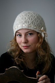 Tilma. a two-layer hat. One solid and then over-laid with lace and beads. lovely