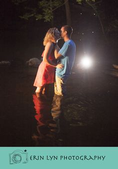 country couple. Engagement photography in a creek with a flash back lighting. www.erinlynphotography.com
