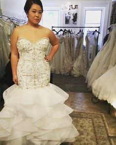 Sparklingly beads and layered ruffles worn by this happy bride to be! #ForeverAmourBridalBoutique