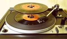 Record players and vinyl. Playing 45s (singles) on the record player. I had a lot of albums (33s) too. Got rid of all of them not that long ago.