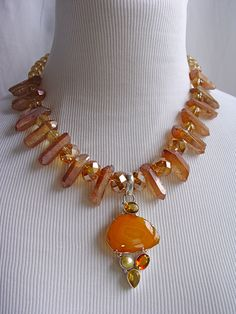 Gorgeous Orange Agate Pendant Embellished with Orange & Champagne Quartz, Crystals, Pearl, and Deep Peach Titanium Spears that Have Pink & Turquoise Flash!  From the Dixie Reinhardt Collection.