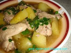 """Tinola or Tinolang Manok (Chicken Stewed with Ginger & Green Papaya)  Recipe posted by: Reel and Grill Blog Course: Soups/Filipino The Philippines' answer to this classic feel-good soup is its """"tinolang manok"""" or simply """"tinola"""". A soupy chicken stewed dish flavored with ginger and added with green papaya and chili leaves. http://reelandgrill.blogspot.com/2010/11/tinola-or-tinolang-manok-chicken-stewed.html"""