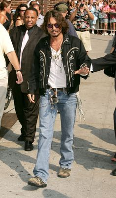 A Look Back At Johnny Depp's 'Iconic' Style: 2006: Lots of embellishments and accessories that only he could pull off.