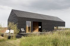Stealth Barn :: http://www.ct-architects.co.uk/stealth-barn-2-2/ (I really don't like the interior of this barn but the exterior is very striking).