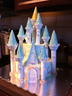 """Princess Castle Cake.  It was my first """"grand"""" cake attempt, so it's a bit rough around the edges.  My baby girl loved it though."""