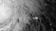 "A satellite image shows Hurricane Sandy as it hovers over the Caribbean early Thursday before heading northeast. Forecasters were predicting a possible triple whammy -- three systems combining into a mega-storm, or ""Frankenstorm."""