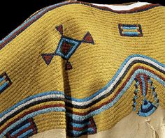 """Example of intricate beadwork on an 1865 Sioux dress. Taken from """"Identity by Design"""" an exhibit at the National Museum of the American Indian."""