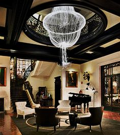 Hotel Infante Sagres Portugal with gigantic custom chandeliervintage floor lamps, mid-century modern lighting, unique lamps, stilnovo lamps, dining table Lamps, vintage desk lamps, brass sconces