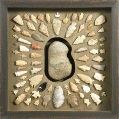 "Arrowhead collection centered around rock display in a Bradley's custom frame. ""Like"" Bradley's on Facebook! https://www.facebook.com/bradleysartandframe?ref=hl"