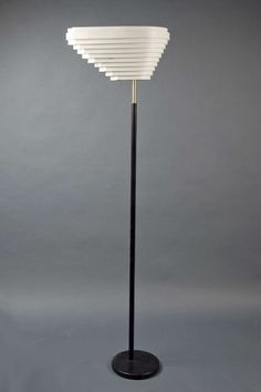 Floor Lamp by Alvar Aalto for Artek | From a unique collection of antique and modern floor lamps  at https://www.1stdibs.com/furniture/lighting/floor-lamps/