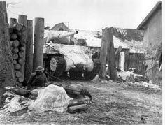 Sherman tank, defences in village near Colmar Alsace France 1945, Lee Miller.