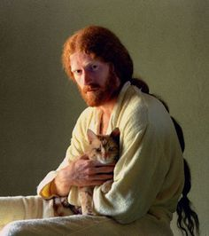 portrait of redhead bearded guy with cat