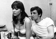 "Pillow talk - actress Anna Karina (b. 1940), with actor Jean-Paul Belmondo (b. 1933), in Jean-Luc Godard's film, ""Une femme est une femme,"" 1961."
