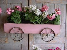 Planter Box Pink Wagon Wall Mounted French Country Cottage Farmhouse Beach Hand Forged Iron Wheels. $125.00, via Etsy.