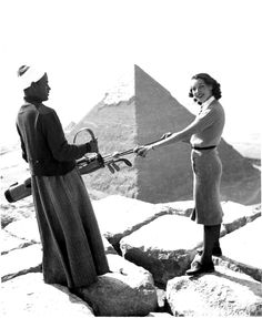 Nora Duggan tees off from the pyramid of Cheops toward the ninth fairway of nearby Mena House GC March 1939