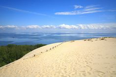 Nida Dunes Nida is Lithuania's loved resort town on the Curonian Spit. Nida is located close the great white dunes that help to make it superb. The major attraction in Nida is the spectacular white sand dunes that build one of the most memorable shows, next to the Hill of Crosses, that Lithuania has to offer.