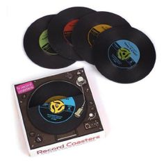 """Record Coasters (Set of 4) by Generic. $9.10. A new spin on protecting your furniture. Each silicone coaster measures 4"""" in diameter. Dishwasher Safe. Set of 4 coasters. Perfect for gift giving. Enjoy this set of four silicone record coasters every time you're drinking your favorite hit beverage. Washable and dishwasher safe, these coasters will put a new spin on protecting your furniture. Each record coaster measures 4"""" in diameter."""