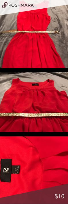 Red casual dress❤️ This sleeveless bright red dress gathers at the waist. Nice and flowy! Giving away the sparkly gold belt for free Dresses
