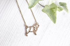 Make a statement with this unique and handcrafted origami style necklace. The signature design features the familiar outline of a pug and is available in 18k gold with a 45cm/18' chain.FREE worldwide shipping! 30-day money-back guarantee.