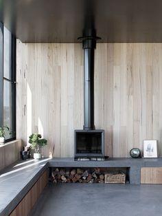 Three Black Timber Pavilions Connected by a Masonry Wall: Fish-Creek House Fireplace Seating, Fireplace Hearth, Home Fireplace, Fireplace Design, Fireplaces, Wood Stove Hearth, Freestanding Fireplace, Masonry Wall, Long Walls