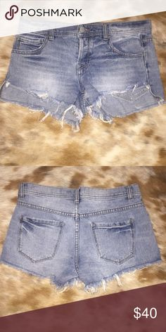 Free people cut off jean shorts Free people cut off jean shorts! Love these shorts but are a little big for me. they are size 26 but run a little big, the waist is a little larger than a normal 26. they are in great condition and are super cute and comfortable! the front is shorter than the back, so it covers your butt. Free People Shorts Jean Shorts
