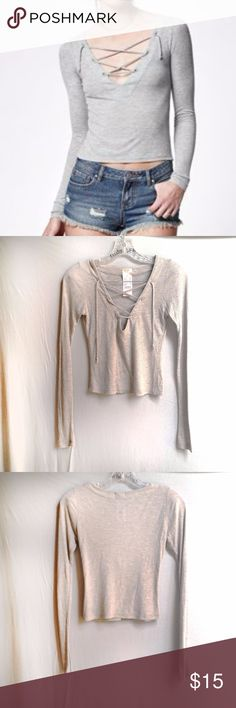 """NWT John Galt Pacsun Grey Lace Up Knit Top OS NWT light grey lace up long sleeved knit top. No flaws or stains.  Shoulder to Hem: 19"""" Sleeve Length: 26"""" Shoulder to Shoulder: 13"""" Tag Size: One Size Brand: John Galt - Pacsun Brandy Melville  #tothedunes #base #laceup #simple #brandy #pacsun #grey #modern #chic #casual #street Brandy Melville Tops Tees - Long Sleeve"""
