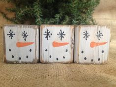 Snowman Trio Cube Primitive Shelf Sitter Blocks    Each of the 3 blocks has a base coat of white a snowman face. The blocks/cubes measures