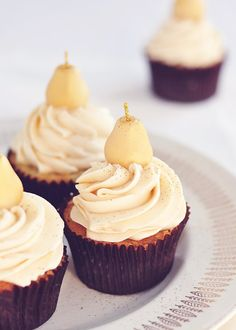 Pear & Marzipan Cupcakes via Sweetapolita-the pears on top are made out of marzipan!!! Aren't these cute?? I love the flavor combo too!
