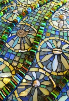 """Wilma Wyss """"Letting Go"""", 2012, stained glass, glass tile, smalti, shells, ammonite fossils, stone, abalone shell, ceramics, antique porcelain dolls arms"""