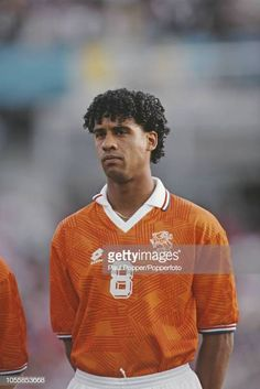 Dutch professional footballer Frank Rijkaard, midfielder with AC Milan, posed prior to playing for the Netherlands national team in the UEFA Euro 1992 Championship tournament in Sweden in June Get premium, high resolution news photos at Getty Images Soccer Poster, Ac Milan, Football Shirts, All Star, Dutch, Athlete, Polo Ralph Lauren, Poses, Euro