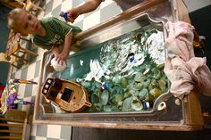 Pirate ideas including a water table with shells across the bottom - looks fantastic, and a great use from all those leftover shells from Ocracoke!