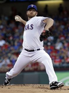Texas Rangers starter pitcher Ryan Dempster (46) throws during the first inning of a baseball game against the Los Angeles Angels, Thursday, Aug. 2, 2012, in Arlington, Texas. (AP Photo/LM Otero)