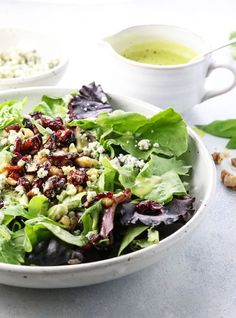 A favorite salad for summer, topped with gorgonzola cheese, dried fruit, nuts, and a refreshing orange basil vinaigrette.