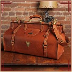 Perfect for weekend travels. Grip Bag American Buffalo rugged leather with unique design features & adjustable shoulder strap. Leather Duffle Bag, Leather Luggage, Leather Wallet, Travel Luggage, Luggage Bags, Travel Bags, Leather Handle, Leather Men, Brown Leather
