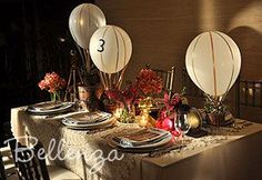 """Hot air balloon"" table numbers - this is SUCH a cute idea for a travel themed party!"