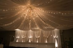 Draping, uplights, pendants, chandelier and twinkle lights.