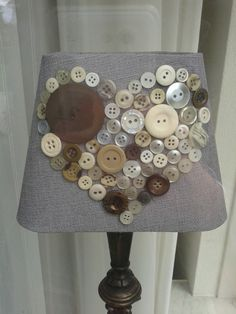 Decorate lampshade with cute buttons