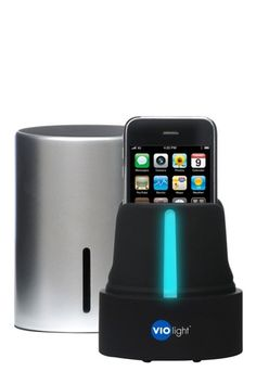 """UV Cellphone Sterilizer! """"Now you can sanitize cell phones and other small devices like Blue tooth headsets, ear buds, and MP3 players in just minutes with the Violight UV Cell Phone Sanitizer. Dual UV bulbs sanitize your device eliminating up to 99.9% of germs in less than 5 minutes."""""""