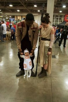 This Adorable Family Just Put Your Star Wars Halloween Costume Goals to Shame ~ couple cosplay as Finn & Rey from TFA with baby BB-8 ~ so cute! | via PopSugar